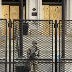 Members of the Wisconsin National Guard stand inside the barricade outside the Kenosha County Courthouse, more than a week after police shot Jacob Blake, prompting unrest in the Wisconsin city, Tuesday morning, Sept. 1, 2020. President Donald Trump is scheduled to visit Kenosha Tuesday afternoon to survey areas affected by the unrest and meet with local officials.