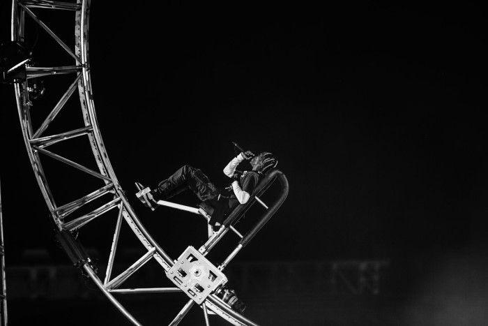 Travis Scott Performing On A Roller Coaster Wheel