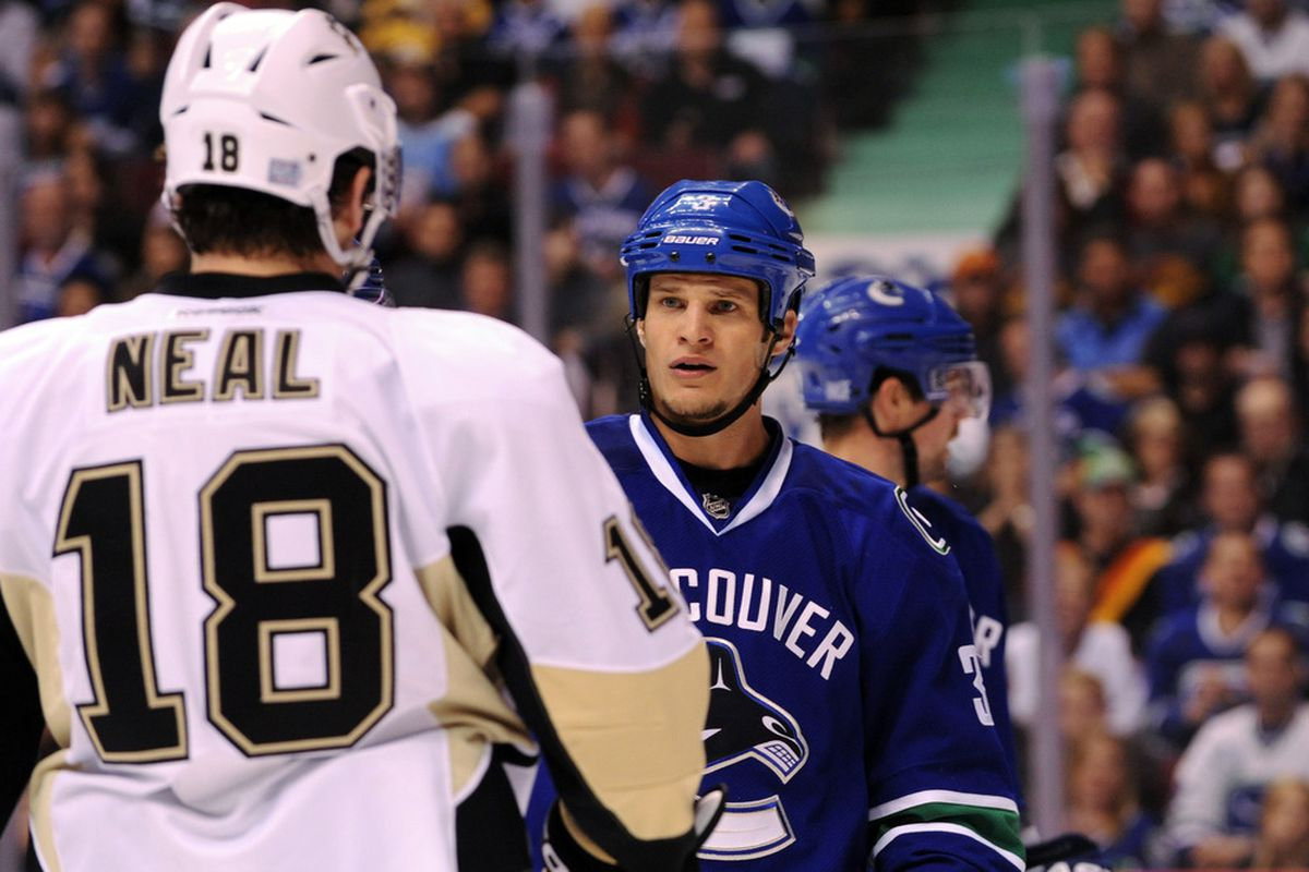 Bieksa ponders who long he'll let Neal be conscious before he makes him take a nap (Photo by Marissa Baecker/Getty Images)