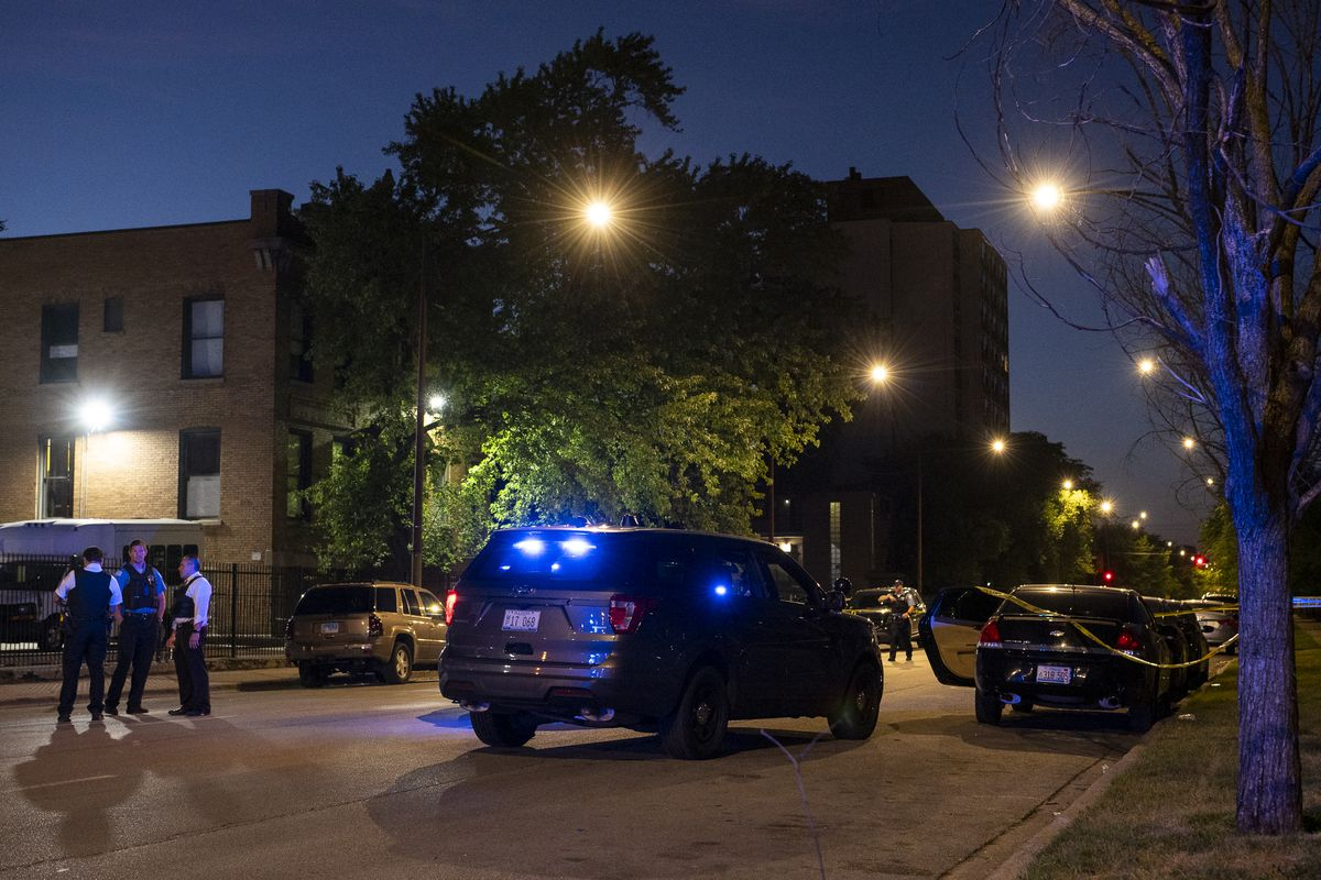 Chicago police work the scene where a vehicle struck and critically wounded a Chicago Police Officer at in the 6300 block of South Michigan, afterwards it was abandoned in the 6100 block of South Indiana, in the Washington Park neighborhood, Friday, Aug. 13, 2021.