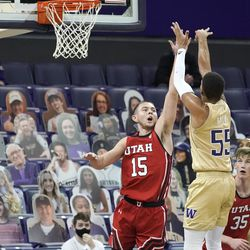 Washington guard Quade Green (55) shoots over Utah guard Rylan Jones (15) during the second half of an NCAA college basketball game, Sunday, Jan. 24, 2021, in Seattle. Washington won 83-79.