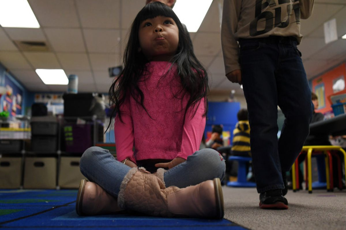 Suri Nguyen, 6, is the first kindergarten student to sit on the carpet with a bubble in her mouth at Lakewood's Westgate Elementary School.