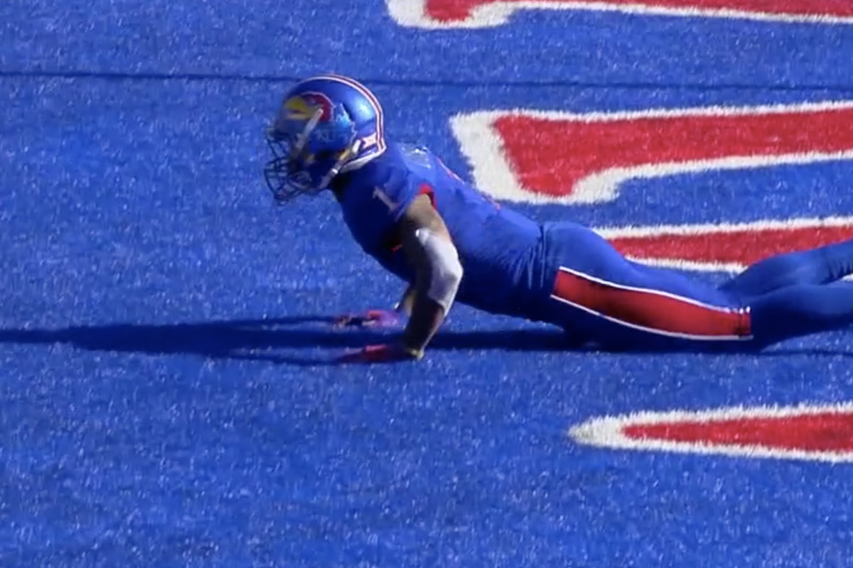 A Kansas player hides in the end zone.