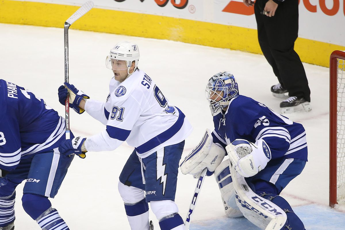 Stamkos (left) and Bernier (right) and the center ring of the Toronto media circus.