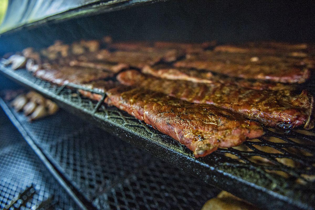 Pork ribs in a smoker.