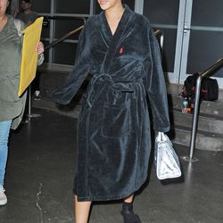 May 27th: Rihanna leaves an all-night photo shoot in a Polo bathrobe and her furry Puma shower slides.