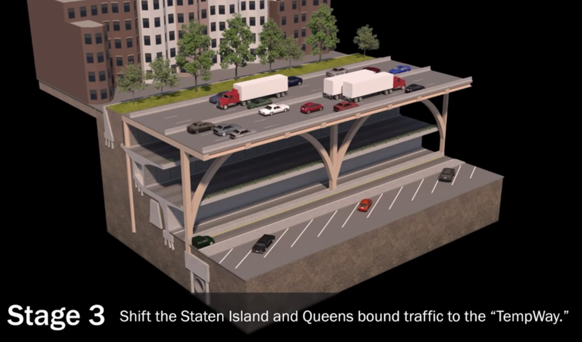 A diagram of the triple cantilever section of the Brooklyn Queens Expressway. Three tiers of road are shown. On the top level trucks and cars are driving on the road.