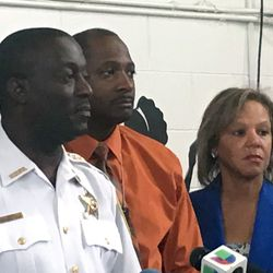 Hazel Crest Police Chief Mitchell Davis (left) and U.S. Rep. Robin Kelly (right) spoke at a news conference Sunday.   Mitch Dudek/Sun-Times