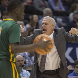 Brigham Young Cougars head coach Dave Rose yells as San Francisco Dons guard Souley Boum (0) takes the ball down the court during BYU's 75-73 overtime win at the Marriott Center in Provo on Saturday, Feb. 10, 2018.