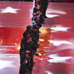 The Utah Jazz players line up for the national anthem in Salt Lake City on Saturday, Dec. 26, 2020.