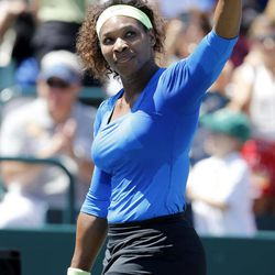 Serena Williams points to the crowd after her match against Samantha Stosur, of Australia, in the semifinals of the Family Circle Cup tennis tournament in Charleston, S.C., Saturday, April 7, 2012.  Williams advanced to the finals by winning 6-1, 6-1.