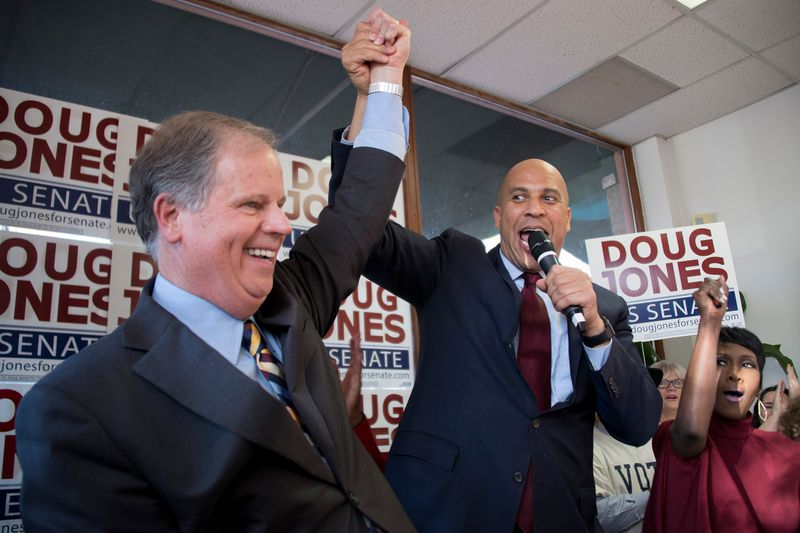 Senator Cory Booker (D-NJ) and Doug Jones at Jones' campaign headquarters in Birmingham, Alabama, on December 10, 2017. Jones was the surprise winner of ultra-conservative Alabama's special election, but he will be in a tough battle to keep his seat in 20