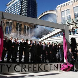 Dignitaries pull the ribbon and applaud to officially open City Creek Center in Salt Lake City, Thursday, March 22, 2012.