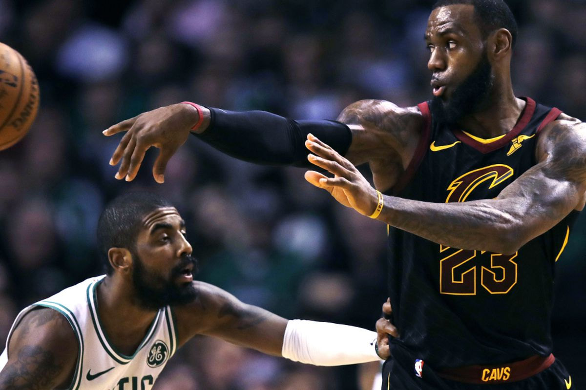 6cc1264e9479 Cleveland Cavaliers forward LeBron James (23) passes the ball as Boston  Celtics guard Kyrie Irving defends during the second quarter of an NBA  basketball ...