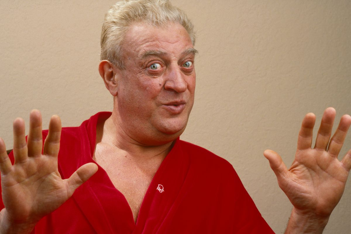 Rodney Dangerfield holding up his hands and looking askance.