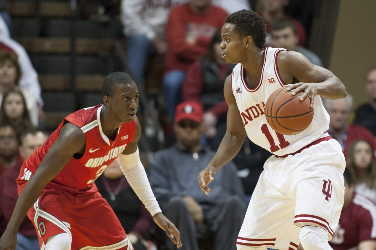 Ohio State's Shannon Scott (3) and Indiana's Yogi Ferrell (11) are quite familiar with each other
