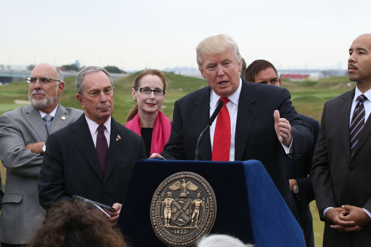 Donald Trump speaks alongside former Mayor Michael Bloomberg at the opening of the Trump Golf Links in The Bronx, Oct. 16, 2013.