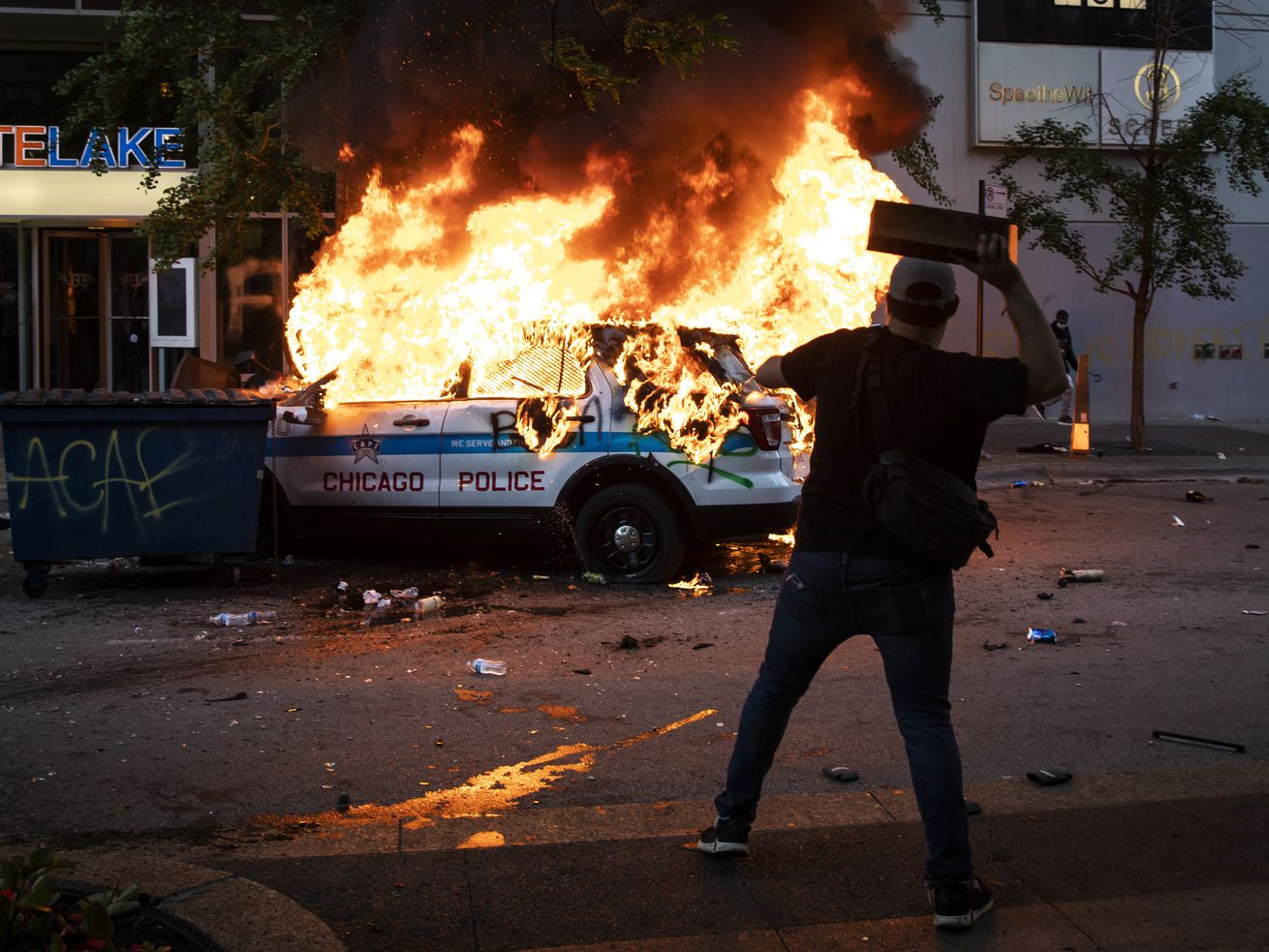 A Chicago Police Department SUV is set on fire near State and Lake in the Loop as thousands of protesters in Chicago joined national outrage over the killing of George Floyd in Minneapolis police custody, Saturday afternoon, May 30, 2020.