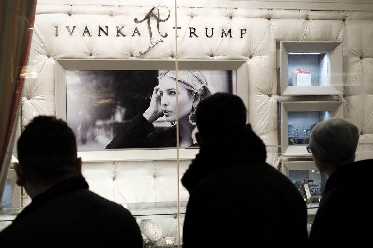A group of people walk past the Ivanka Trump Collection shop in the lobby at Trump Tower in New York City.