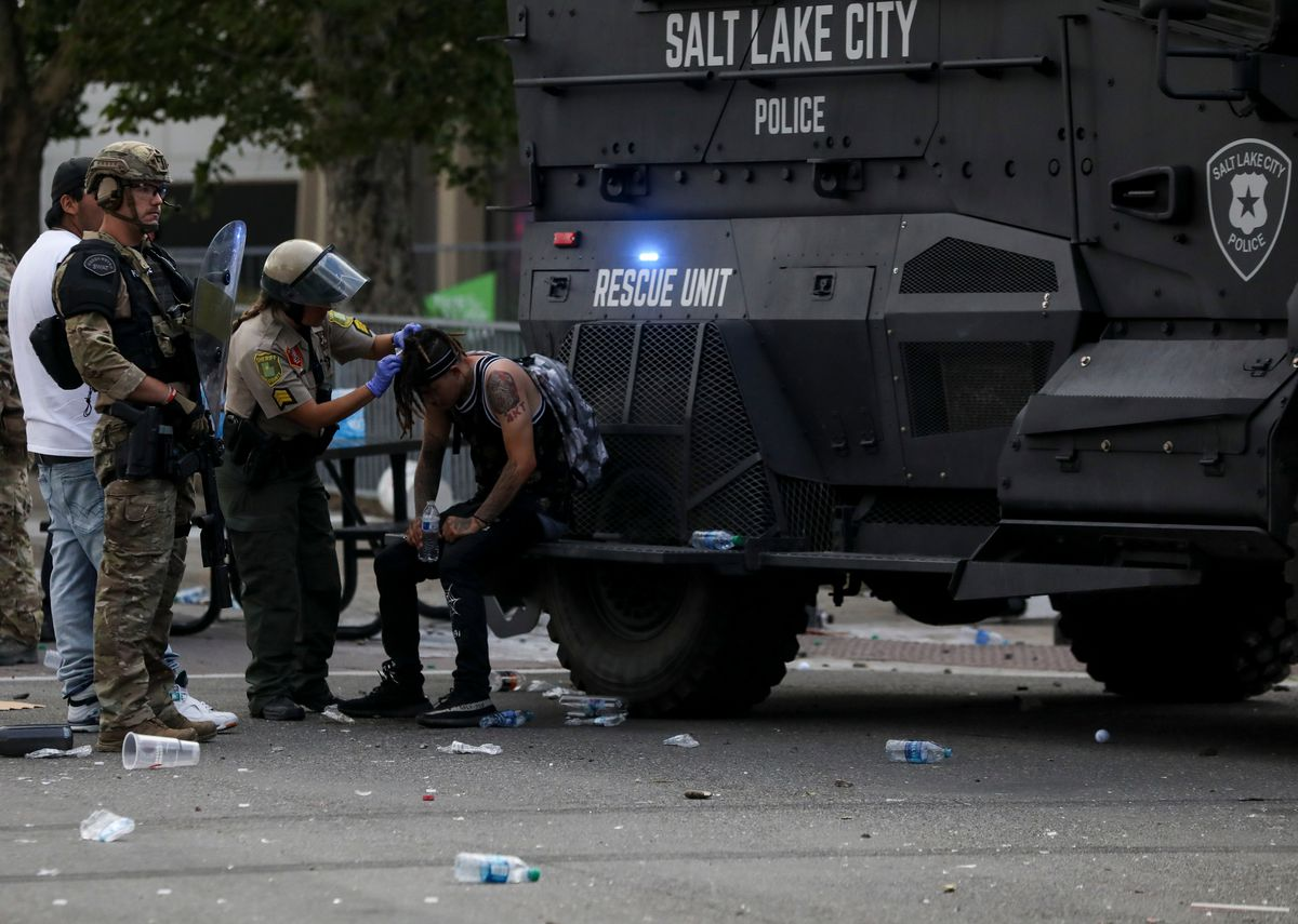 A protester gets treated by law enforcement in Salt Lake City on, Saturday, May 30, 2020.