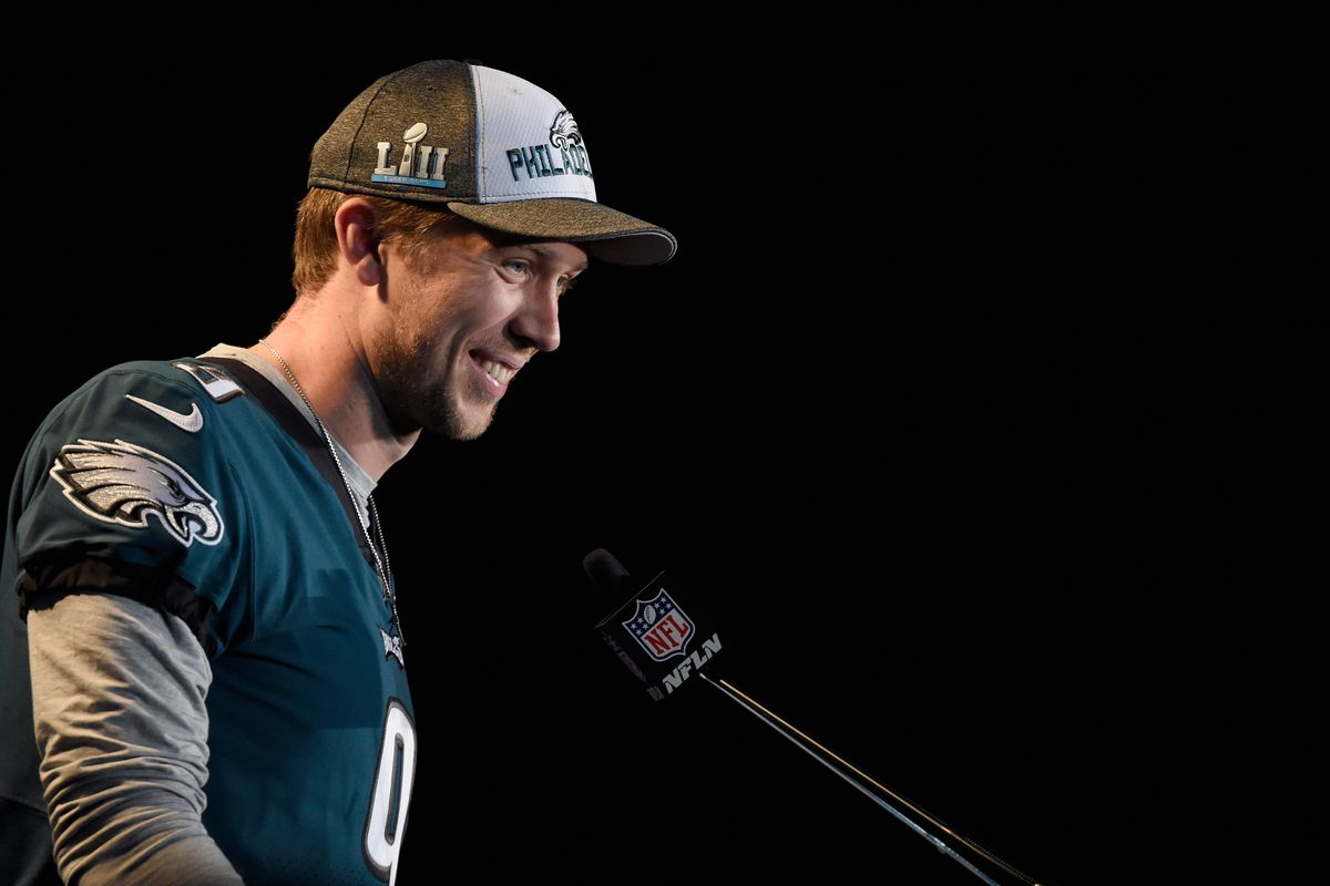 Nick Foles speaks into a microphone
