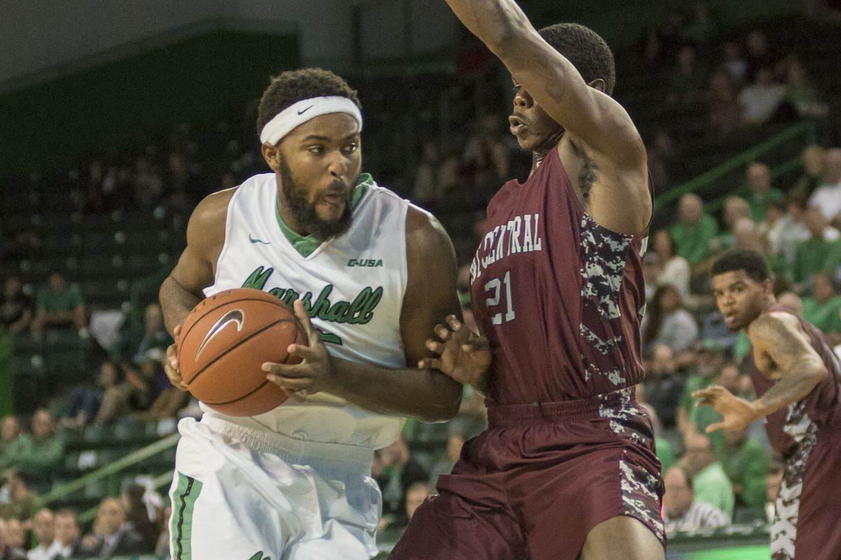 Ryan Taylor (25) streaks to the basket for the Herd.