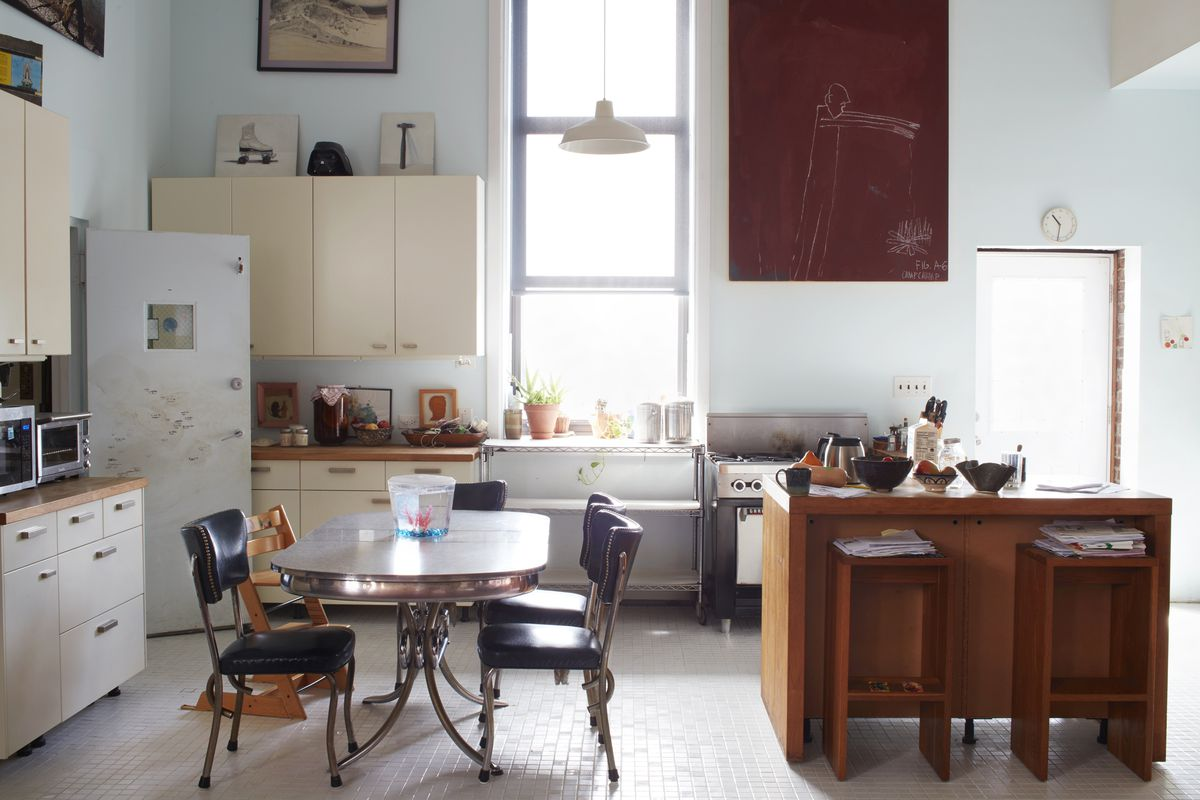 Anthony and Susannah Abbate use simple white cabinets from IKEA as a placeholder, waiting for a more in-depth remodel. A vintage kitchen table is from the 1950s.