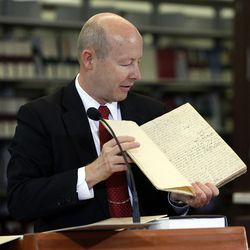 Assistant Church Historian and Recorder Richard E. Turley Jr of The Church of Jesus Christ of Latter-day Saints displays historical documents during a press conference announcing the release of the latest volume in the church's ongoing Joseph Smith Papers project in Salt Lake City, Wednesday, Sept. 4, 2013. This is a book of revelations received in Kirtland, Ohio.