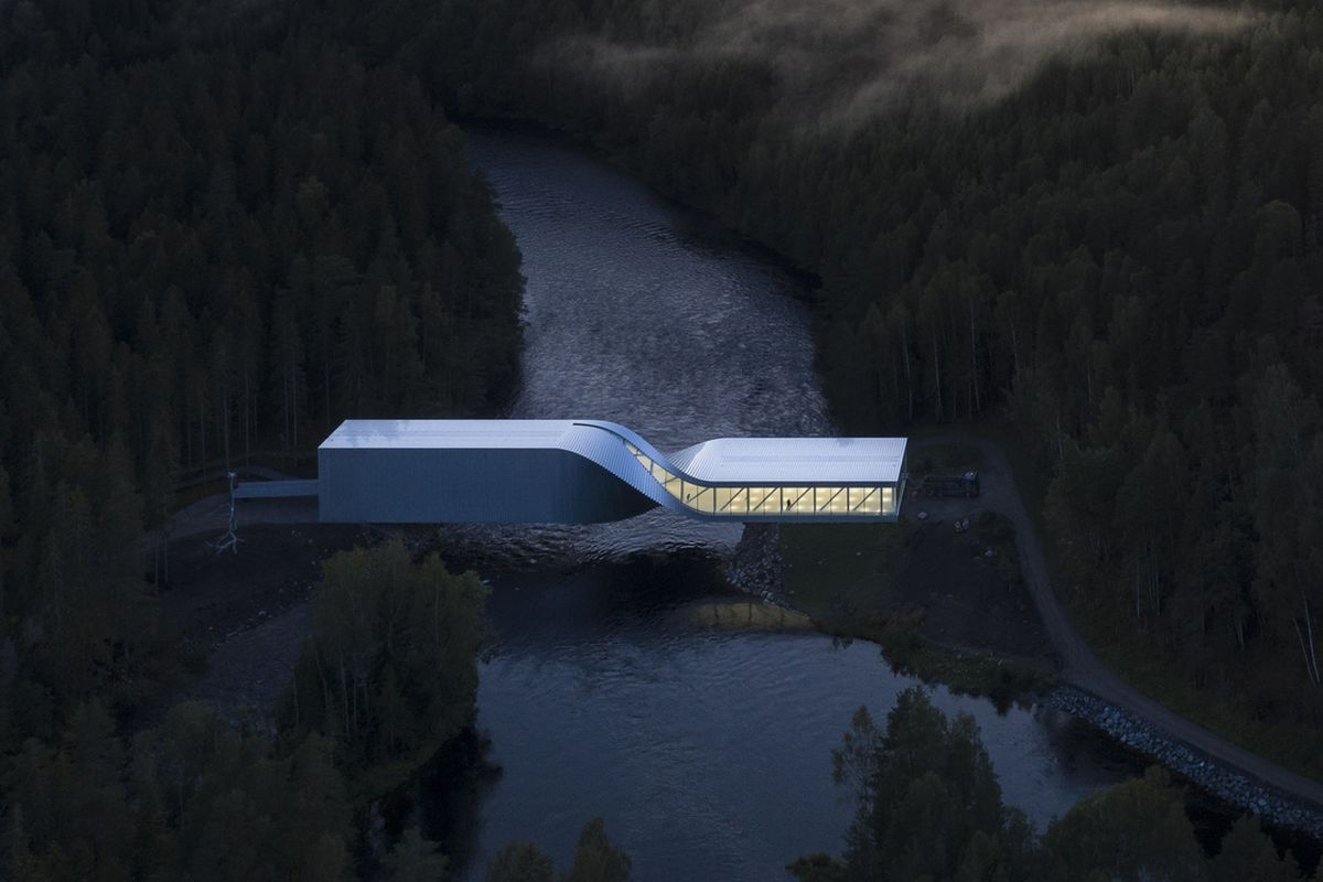 Aerial shot of white bridge that appears to twist in the middle. It spans a river, flanked by forests.