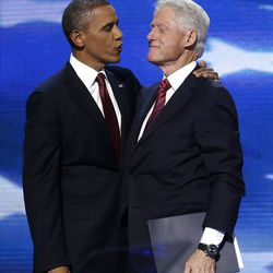 President Barack Obama talks to Former President Bill Clinton during the Democratic National Convention in Charlotte, N.C., on Wednesday, Sept. 5, 2012. (AP Photo/Charles Dharapak)