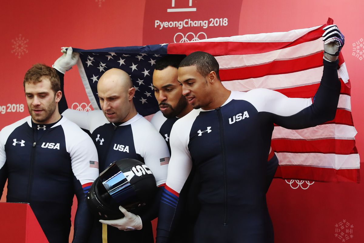 Nick Cunningham, Hakeem Abdul-Saboor, Chris Kinney and Samuel Michener of the United States watch fellow competitors run during the four-man bobsled heats at the PyeongChang 2018 Winter Olympic Games.
