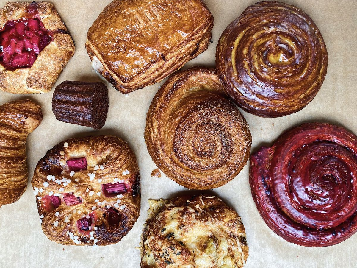 A number of laminated pastries sit on a counter at Ken's Artisan Bakery