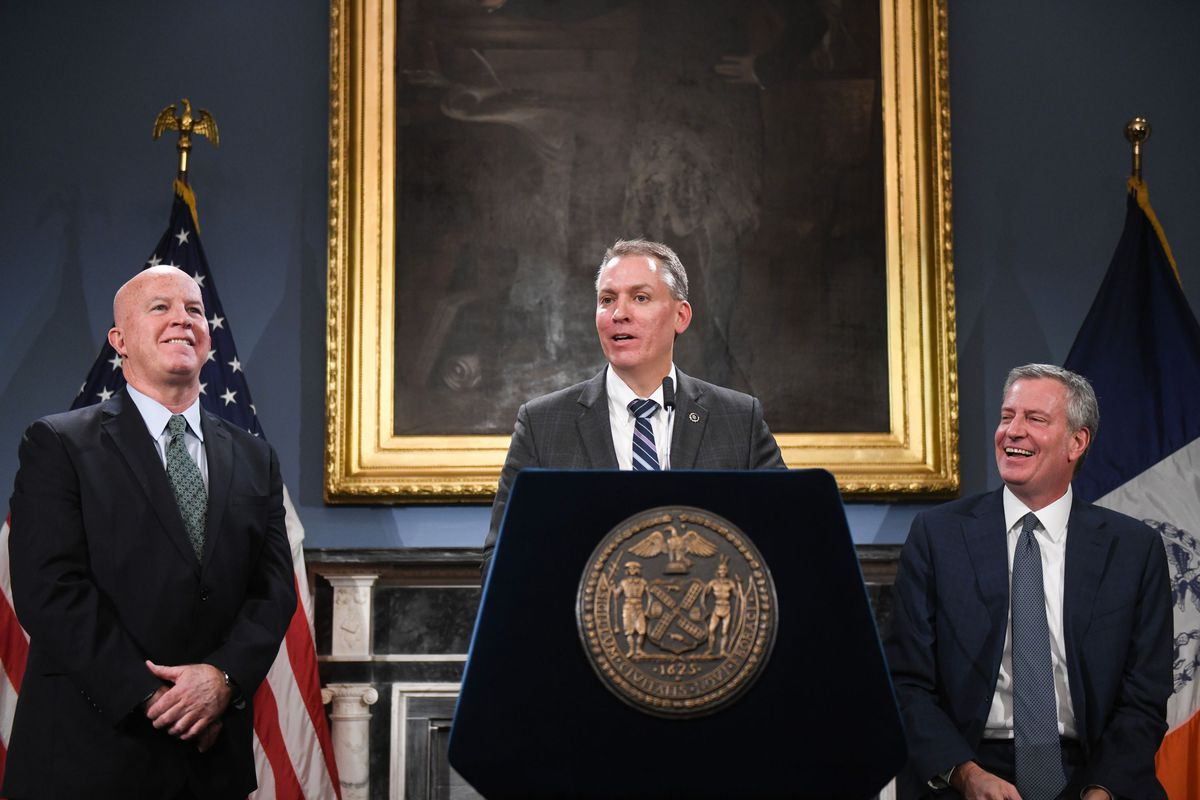 Former NYPD Commissioner James O'Neill (l.) looks on as Mayor Bill de Blasio announces Dermot Shea (c.) will be new head of NYPD. Nov. 4, 2019.