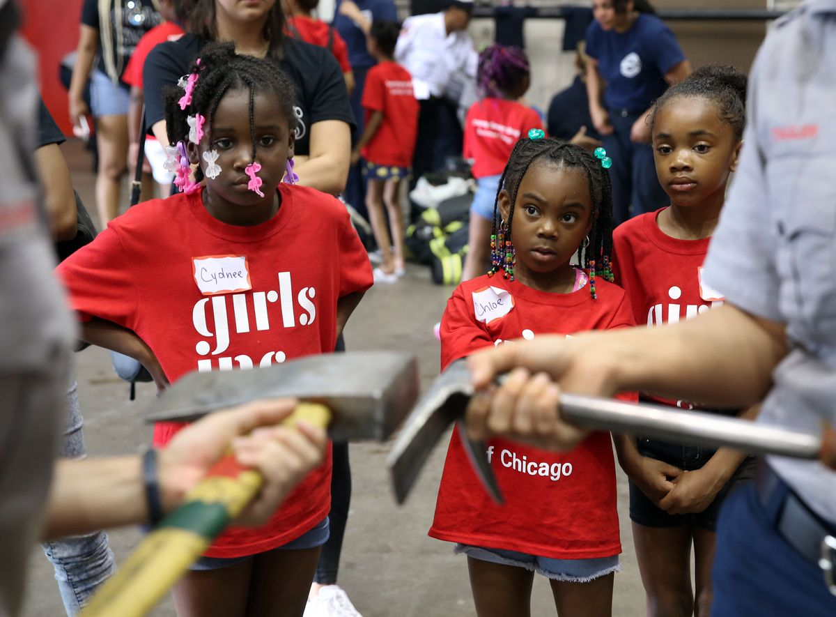 Cydnee, Chloe and Raina learn how firefighters' tools are used