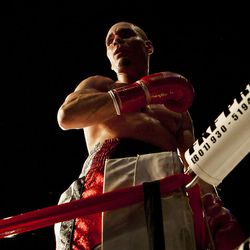 """Chris """"KidKayo"""" Fernandez stands on the corner of the ring at the South Towne Expo Center after winning bout against Allen Litzau after four rounds, Saturday, Dec. 15, 2012."""