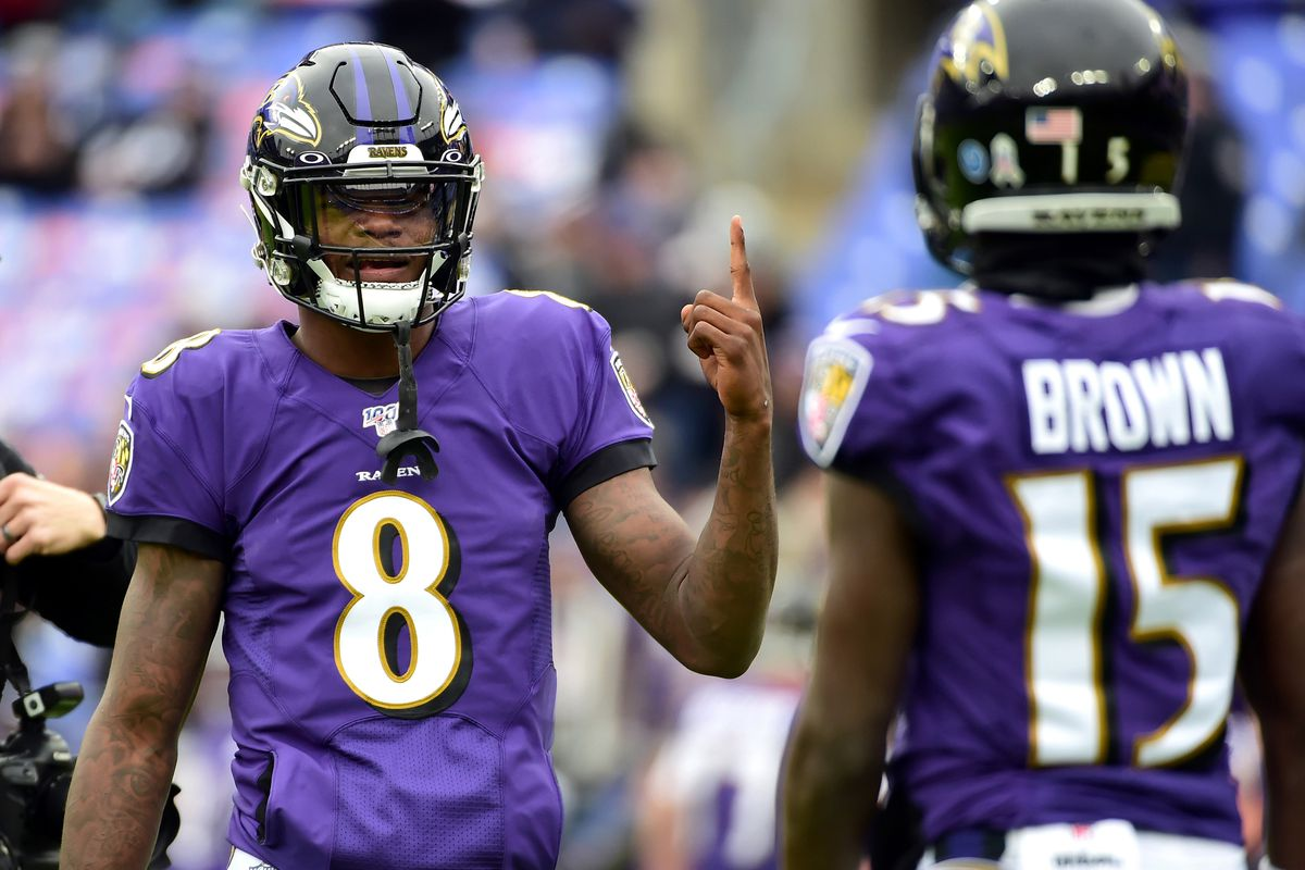 Baltimore Ravens quarterback Lamar Jackson talks to wide receiver Marquise Brown prior to their game against the Houston Texans at M&T Bank Stadium.