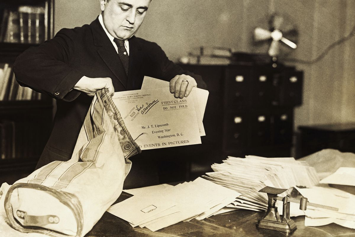 David Weissberg Putting Letters into a Mailbag