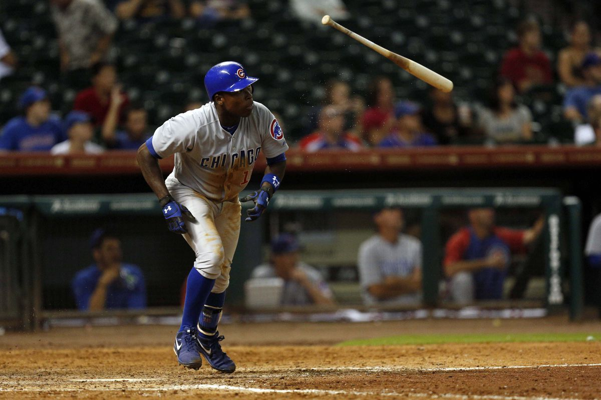 Sept 12, 2012; Houston, TX, USA; Chicago Cubs left fielder Alfonso Soriano (12) hits a double against the Houston Astros during the ninth inning at Minute Maid Park. The Cubs won 5-1. Mandatory Credit: Thomas Campbell-US PRESSWIRE