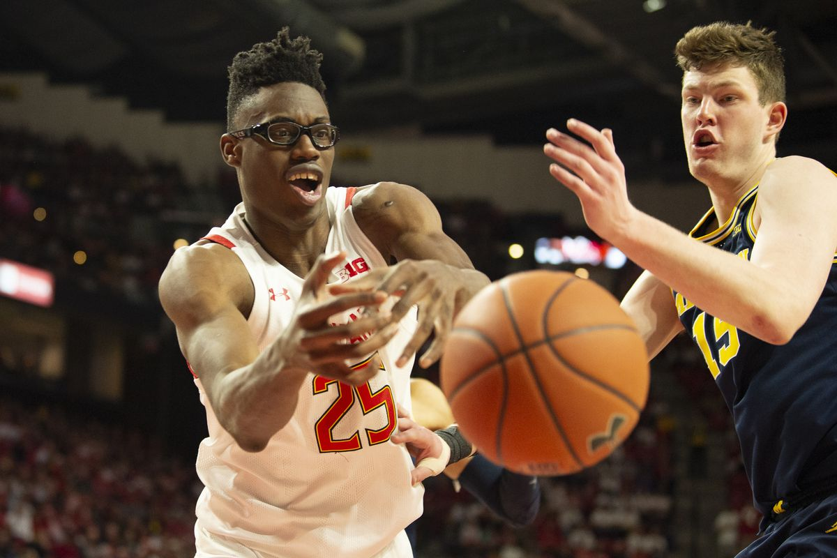 Maryland Terrapins forward Jalen Smith and Michigan Wolverines center Jon Teske reach for a loose ball during the second half at XFINITY Center.
