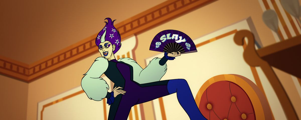 """Twink, a drag-queen character from Netflix's Q-Force, poses on a table, in a purple, star-filled bouffant and holding up a fan that says """"SLAY"""""""