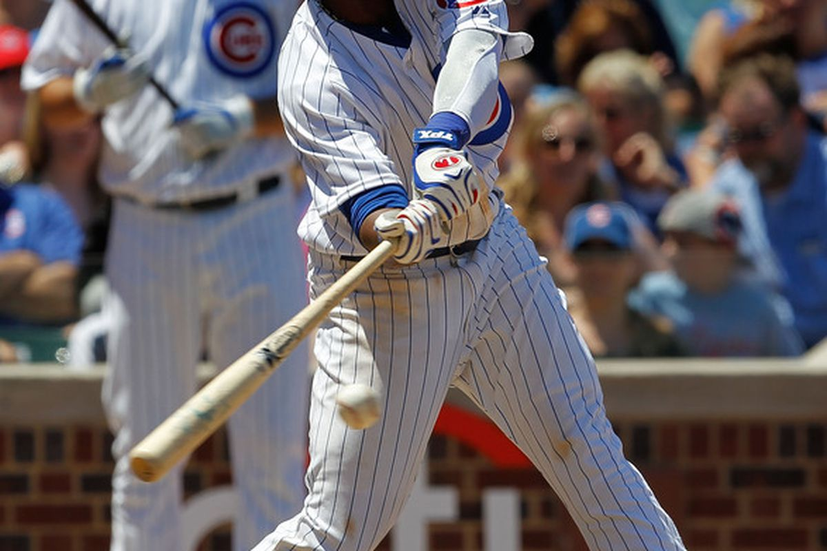 CHICAGO - JULY 03: Starlin Castro #13 of the Chicago Cubs hits the ball in the 4th inning against the Cincinnati Reds at Wrigley Field on July 3 2010 in Chicago Illinois. The Cubs defeated the Reds 3-1. (Photo by Jonathan Daniel/Getty Images)