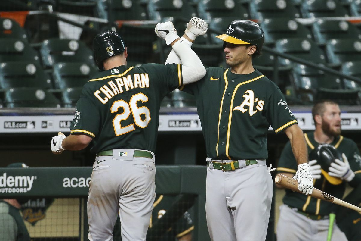 Oakland Athletics third baseman Matt Chapman celebrates with first baseman Matt Olson after hitting a home run during the fourth inning against the Houston Astros in game two of a double header at Minute Maid Park.