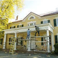 Workers finish the restoration of Dodona Manor, above, the former home of George C. Marshall, in Leesburg, Va.