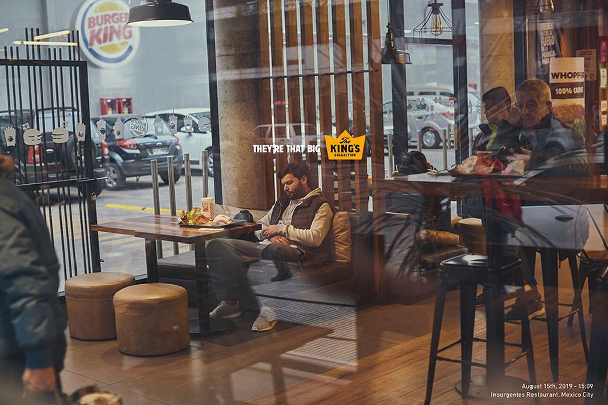 A man sleeping in a Burger King