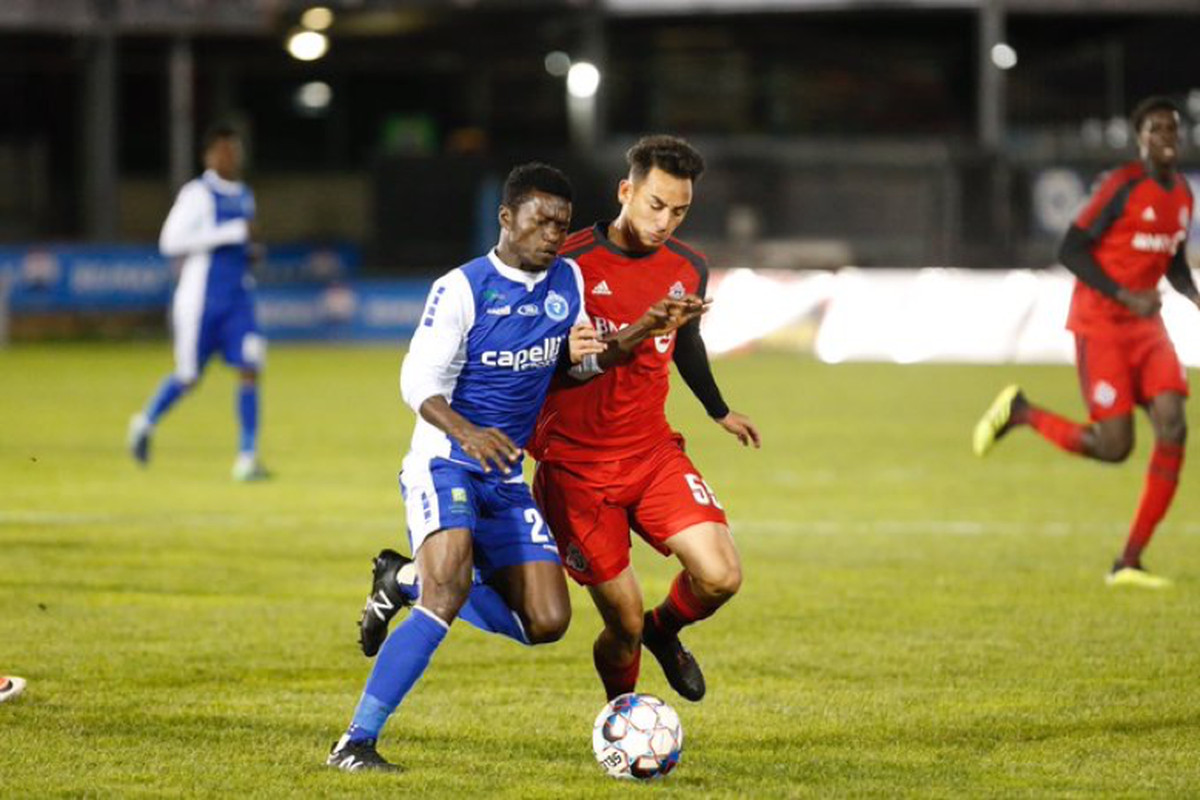 USL Photo - Toronto FC II's Aidan Daniels battles for a ball in midfield against Penn FC in the 0-0 draw between the sides that ended the 2018 USL season for both