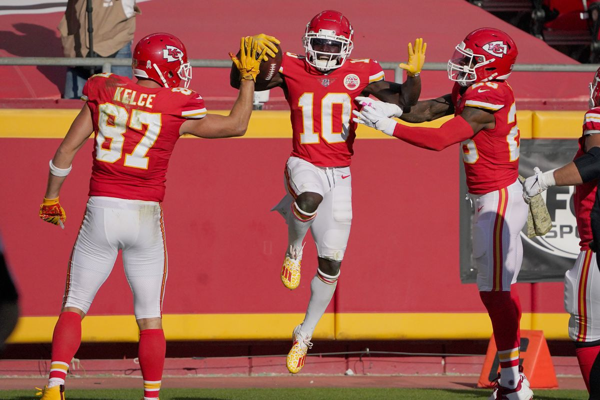 Kansas City Chiefs wide receiver Tyreek Hill (10) celebrates with tight end Travis Kelce (87) and running back Clyde Edwards-Helaire (25) after scoring against the Carolina Panthers during the second half at Arrowhead Stadium.