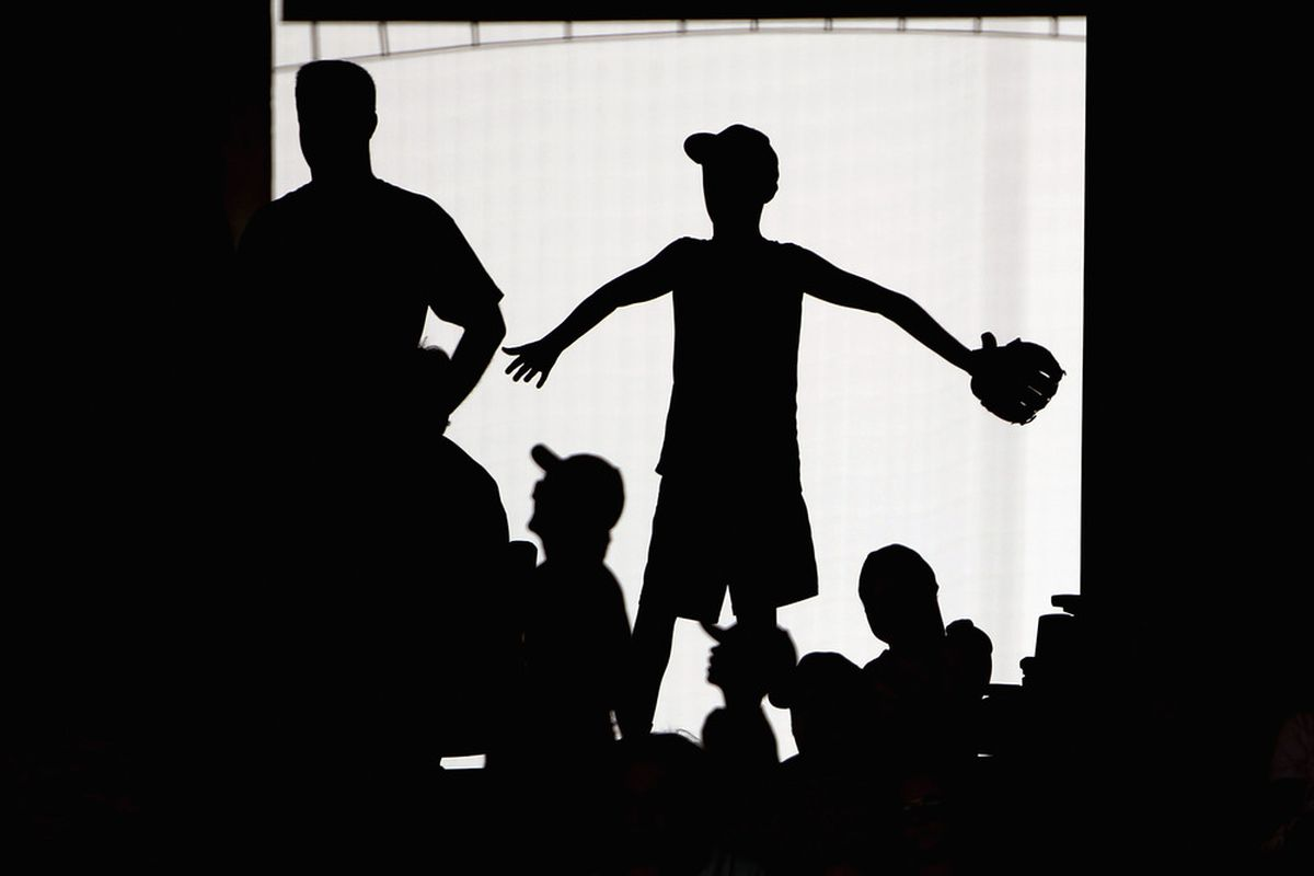 KANSAS CITY, MO - JULY 24:  A fan watches from the main concourse during the game between the Tampa Bay Rays and the Kansas City Royals on July 24, 2011 at Kauffman Stadium in Kansas City, Missouri.  (Photo by Jamie Squire/Getty Images)
