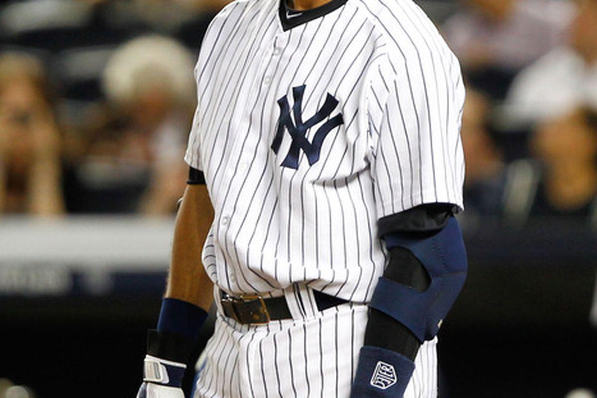 New York Yankees shortstop Derek Jeter reacts after striking out looking against the Kansas City Royals. Mandatory Credit: Debby Wong-US PRESSWIRE