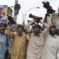 In this Tuesday, April 17, 2012 photo, Pakistani journalists chant slogans during a demonstation in Quetta, Pakistan. The telephone call to local journalists generally comes in the late evening. The voice on the other end is usually a Sunni militant with a statement he wants printed threatening of violence or claiming responsibility for attacks that already occurred. Journalists fear being killed if they don't print the messages.