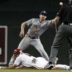 Arizona Diamondbacks' Adam Eaton (6) steals second base as San Diego Padres' Logan Forsythe waits for a late throw while umpire Paul Nauert watches during the first inning of a baseball game Tuesday, Sept. 18, 2012, in Phoenix.